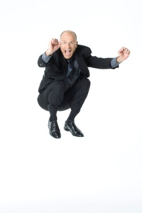 Businessman jumping into the air and looking excited