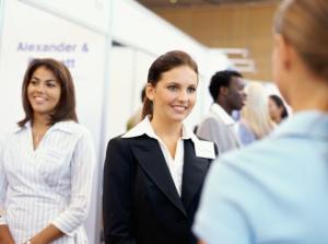 three businesswomen at an exhibition